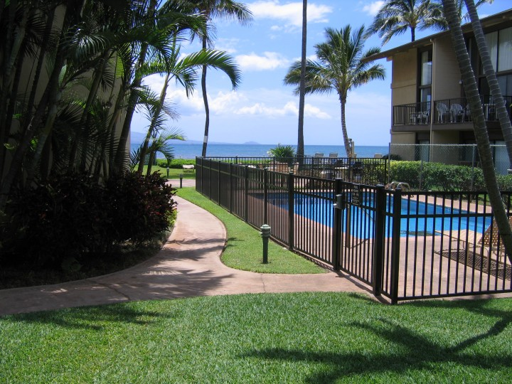 Accessible pathway going past the pool.  Level gras from lanai to pathway